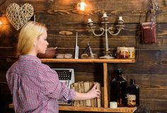 Home library concept. Girl looking for book in house of gamekeeper. Girl in casual outfit in wooden vintage interior. Enjoy literature. Lady blonde in plaid royalty free stock photography
