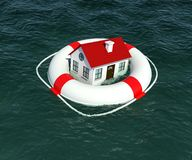 Home and lifebuoy in water Royalty Free Stock Photography