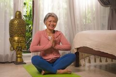 Free Home Lifestyle - Beautiful And Happy Mature Woman With Gray Hair On Her 50s Doing Yoga And Meditation Exercise At Asian Deco Royalty Free Stock Photos - 178847838