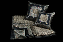 Home  linens and pillows on a black background. Linens and pillows on a black background Royalty Free Stock Photo