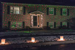 Home lit with holiday green and red lights Stock Images