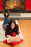 Home living happy woman work computer fireplace Royalty Free Stock Photography