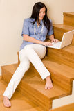 Home living happy woman work laptop staircase Royalty Free Stock Photos