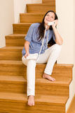 Home living woman call phone sitting staircase Stock Photography