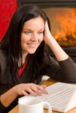 Home living woman with laptop by fireplace Stock Photos