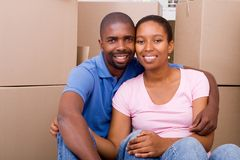 Home loan. Happy young couple just moved in new home, home loan or mortgage concept Royalty Free Stock Image