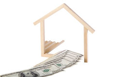 Home Loan. Money leading into a symplistic symbol of a house. Conceptual image for a home loan, construction loan, lending, etc royalty free stock photo
