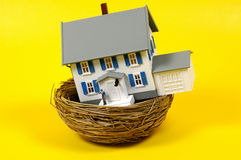Home Loan. Photo of a Model Home in a Nest. Home Loan Concept stock photo