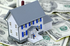 Home Loan. Miniature House on Cash Royalty Free Stock Images