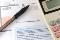 Home loan application form. With calculator and pen nearby royalty free stock photo