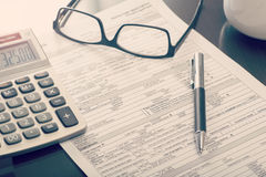 Home loan application form. Close up of a bank home loan application form on desk with calculator and eye glasses stock photos