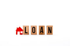 Home Loan. Block letters with red home / house icon with white background royalty free stock images