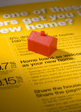 Home Loan Business. A toy house on a home loan brochure stock images