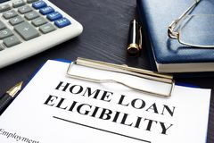 Home loan eligibility documents and glasses. Home loan eligibility documents, money and glasses stock photos