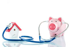 Home loan health check. House stethoscope and piggy bank royalty free stock photography