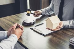 Home loan insurance, Male lawyer or judge Consult with client an. D working with Law books, report the case on table in office, Law and justice concept Royalty Free Stock Images