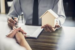 Home loan insurance, Male lawyer or judge Consult with client an. D working with Law books, report the case on table in office, Law and justice concept Stock Image