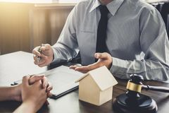 Home loan insurance, Male lawyer or judge Consult with client an. D working with Law books, report the case on table in office, Law and justice concept Royalty Free Stock Photography