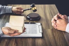 Home loan insurance, Male lawyer or judge Consult with client an. D working with Law books, report the case on table in office, Law and justice concept Royalty Free Stock Photo