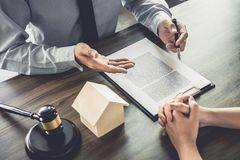 Home loan insurance, Male lawyer or judge Consult with client an. D working with Law books, report the case on table in office, Law and justice concept Stock Photo