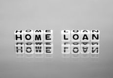 Home loan. Message on reflective surface royalty free stock image