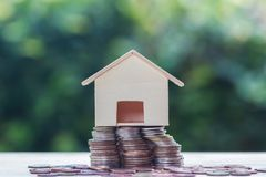 Home loan, mortgages, debt, savings money for home buying concept. Home loan, mortgages, debt, savings money for home buying concept :Stacked coins and small stock photography