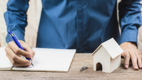 Home loan, Reverse mortgage concept. Estate agent sign the certification contract. Depicts the completion of the agreement in the home trading. Conceptual real stock photos