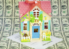 Home loan toy house with some two dollar bills Royalty Free Stock Photography