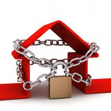 Home locked in chains on white background Stock Photos
