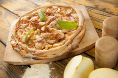 Home made apple cake on the wooden table Stock Photography