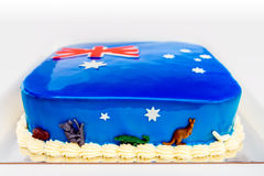 Home made Australia Day cake. Themed under colours of Australian Flag and decorated with koalas and kangaroos Royalty Free Stock Photography