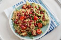 Home made avocado salad with couscous and pomegranate Stock Photos