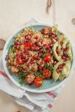 Home made avocado salad with couscous and pomegranate Stock Photography