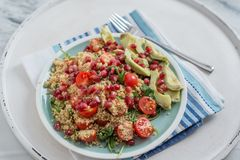 Home made avocado salad with couscous and pomegranate Royalty Free Stock Images