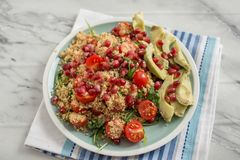 Home made avocado salad with couscous and pomegranate Royalty Free Stock Photos