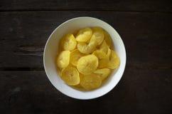 Home made banana chips. Or kerepek pisang, malay traditional chips Royalty Free Stock Photo