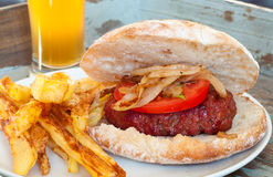 Home made barbecued beef burger Royalty Free Stock Photography