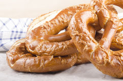 Home made bavarian prezel on baking paper Royalty Free Stock Images