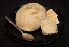 Home made beer cheese soup in a bread bowl stock images