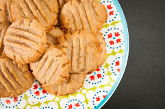 Home made bisuits. Freshly baked, home made tahini biscuits served on a colorful plate Royalty Free Stock Photo