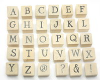 Home Made Blocks Alphabet. Home made wooden blocks spell out the alphabet on white background Royalty Free Stock Image