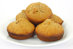 Home made bran muffins. Home baked bran muffins with dates on a plate Stock Photography