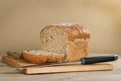 Home made bread. Home made loaf of granary bread on a wooden bread board Stock Photography