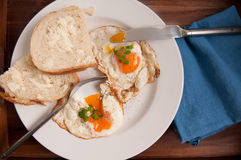 Home made bread and organic fried eggs Royalty Free Stock Photo