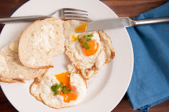 Home made bread and organic fried eggs Stock Photography