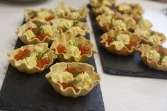 Home-made bread tartlets for fish caviar snacks and egg yolk sauce royalty free stock image