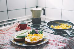 Home made breakfast of eggs, avocado toast and coffee. Stock Photo