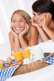 Home made breakfast, two women in background Royalty Free Stock Images