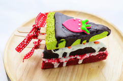 Home made brownies winter tree shape with red bow and ribbon on. Wooden plate Royalty Free Stock Photos