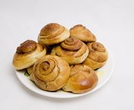 Home-made buns with cinnamon. Buns with cinnamon, baked at home Royalty Free Stock Photo